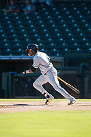Glendale Desert Dogs center fielder Luis Alexander Basabe (15), of the Chicago White Sox organization, follows through on his swing during an Arizona Fall League game against the Surprise Saguaros at Surprise Stadium on November 13, 2018 in Surprise, Arizona. Surprise defeated Glendale 9-2. (Zachary Lucy/Four Seam Images)