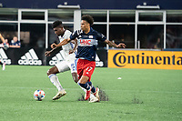 FOXOBOROUGH, MA - AUGUST 21: Gustavo Vallecilla #5 of FC Cincinnati approaches the New England Revolution goal as Tajon Buchanan #17 of New England Revolution defends during a game between FC Cincinnati and New England Revolution at Gillette Stadium on August 21, 2021 in Foxoborough, Massachusetts.