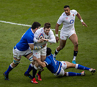 13th February 2021; Twickenham, London, England; International Rugby, Six Nations, England versus Italy; Elliot Daly of England is tackled by Juan Ignacio Brex of Italy