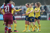 Katie McCabe of Arsenal scores the first goal for her team and celebrates with her team mates during West Ham United Women vs Arsenal Women, Women's FA Cup Football at Rush Green Stadium on 26th January 2020