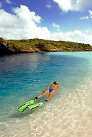 A snorkeler cruises along the shallow edge of the famous Dean's Blue Hole, Long Island, Bahamas, Atlantic Ocean(MR)