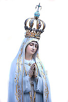 Statue Lady of Fatima,Pope Francis prays in front of Our Lady of Fatima in St. Peter's square at the Vatican on October 12, 2013