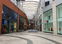 Very few shoppers seen in the Eden Centre Shopping Mall at 3pm in High Wycombe as the Coronavirus (COVID-19) continues worldwide on 18 March 2020. Photo by Andy Rowland.