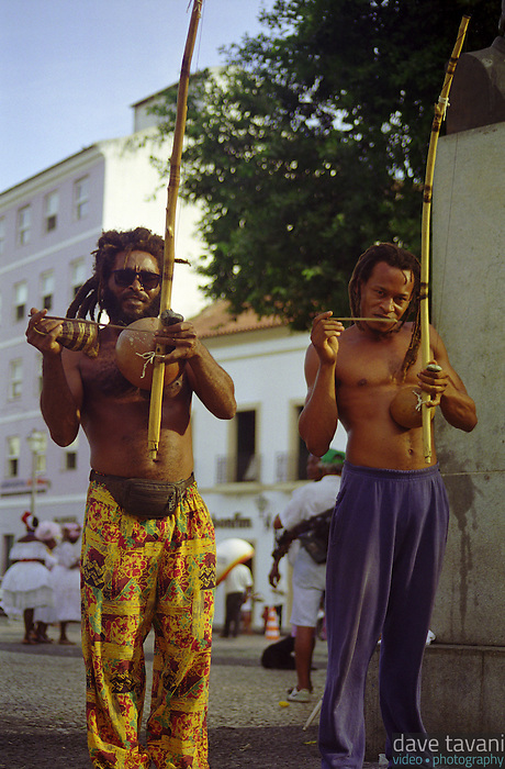 Two men play berimbous, Afro-Brazilian musical instruments often associated with capoeira, in the Pelourinho section of Salvador, Brazil, March 7, 1999.