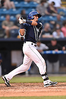 Asheville Tourists catcher Dom Nunez (9) swings at  pitch during a game against the Augusta GreenJackets on April 28, 2015 in Asheville, North Carolina. The Tourists defeated the GreenJackets 7-3. (Tony Farlow/Four Seam Images)