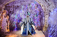 Yakutsk, Yakutia, Russia, 19/08/2011..The Yakut Lord Of Cold Chiskhan on his throne inside the Permafrost Kingdom, an underground tourist attraction inspired by the extreme cold of Yakutia. The 150 metre deep complex of tunnels in the Russian permafrost are decorated with ice sculptures, a wolf-fur covered throne, an office complete with the coolest computer and telephone, a children's slide and other ingenious creations - all hewn from blocks of ice.