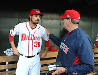 Left handed pitcher Andrew Miller (30) of the Boston Red Sox is congratulated by pitching coach Dick Such (44) following a Major League rehab assignment with the Greenville Drive in a game against the Lakewood BlueClaws on April 7, 2012, at Fluor Field at the West End in Greenville, South Carolina. (Tom Priddy/Four Seam Images)