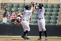 Seby Zavala (21) of the Kannapolis Intimidators is congratulated at home plate by teammate Brandon Dulin (31) after hitting a home run against the West Virginia Power at Kannapolis Intimidators Stadium on June 18, 2017 in Kannapolis, North Carolina.  The Intimidators defeated the Power 5-3 to win the South Atlantic League Northern Division first half title.  It is the first trip to the playoffs for the Intimidators since 2009.  (Brian Westerholt/Four Seam Images)