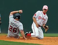 July 8, 2009: Second baseman Zach Gentile (7) lets the ball get by him as Chris Sheehan (26) of the Rome Braves steals second base in a game at Fluor Field at the West End in Greenville, S.C. Photo by: Tom Priddy/Four Seam Images