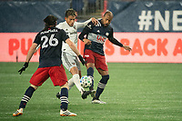 FOXBOROUGH, MA - NOVEMBER 1: Yamil Asad #11 of DC United tackles Teal Bunbury #10 of New England Revolution during a game between D.C. United and New England Revolution at Gillette Stadium on November 1, 2020 in Foxborough, Massachusetts.