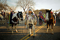 Native American Indians from Montana wait with their horses to march in a parade after the inauguration of Barack Obama as the 44th President of the United States.