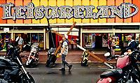 A man hauls a crucifix past the Leiesureland amusement arcade in Great Yarmouth, ,Norfolk,UK July 2019