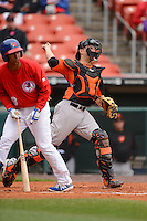 Norfolk Tides catcher Luis Exposito #23 throws down to second as Anthony Gose #8 gets out of the way during a game against the Buffalo Bisons on May 9, 2013 at Coca-Cola Field in Buffalo, New York.  Norfolk defeated Buffalo 7-1.  (Mike Janes/Four Seam Images)