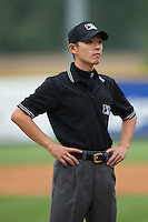 Umpire Kaz Endo prior to the Appalachian League game between the Bluefield Blue Jays and the Burlington Royals at Burlington Athletic Park on July 1, 2015 in Burlington, North Carolina.  The Royals defeated the Blue Jays 5-4. (Brian Westerholt/Four Seam Images)