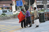 Grace Mugabe with red scarf and glasses,  (subject to identification) and friend with security in Hong Kong's, Kowloon 15th Jan 2005.<br /> <br /> photo ©by Sinopix