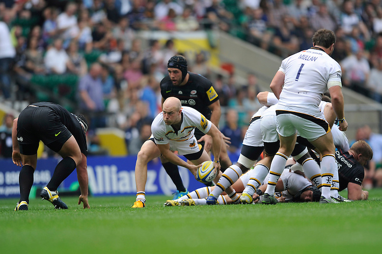 Joe Simpson of Wasps passes during the Premiership Rugby Round 1 match between Saracens and Wasps at Twickenham Stadium on Saturday 6th September 2014 (Photo by Rob Munro)