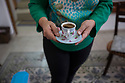 Jerusalem - Shaima Budeiry, 55, the technician in charge of all the digitization in Jerusalem offers Father Columba a cup of Turkish coffee.