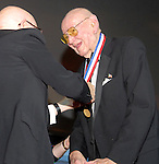 """Photo by Mike Ullery/National Aviation Hall of Fame.David Lee """"Tex"""" Hill recieves his National Aviation Hall of Fame enshrinement medal from fellow Flying Tiger, longtime friend, and 2005 NAHF enshrinee Gen. John Allison during the HOF's 45th annual enshrinement ceremony in Dayton, Ohio."""