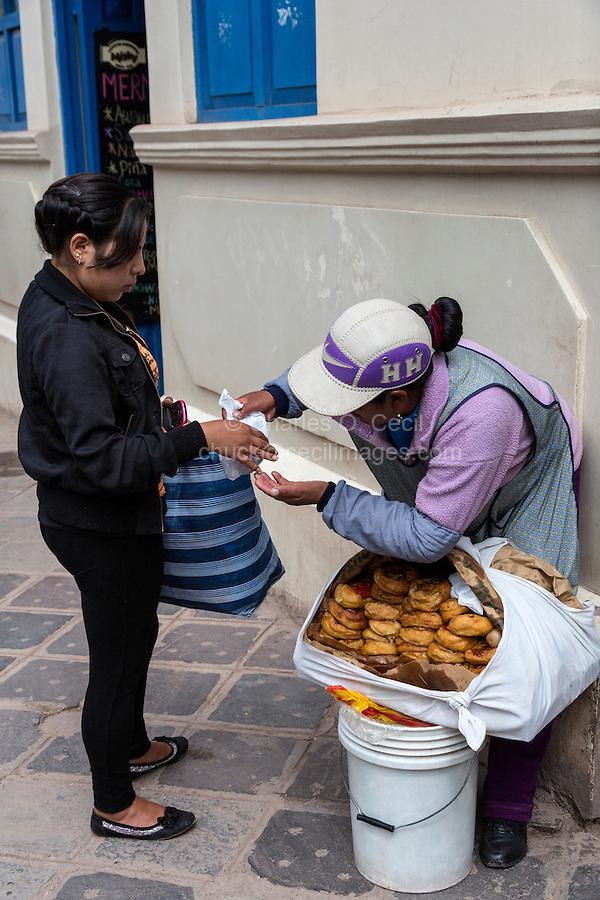Peru, Cusco.  Vendor Selling Pastries on the Street.