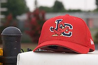 A Johnson City Cardinals cap sits on the top of the visitor's dugout at Burlington Athletic Park in Burlington, NC, Sunday, July 15, 2007.