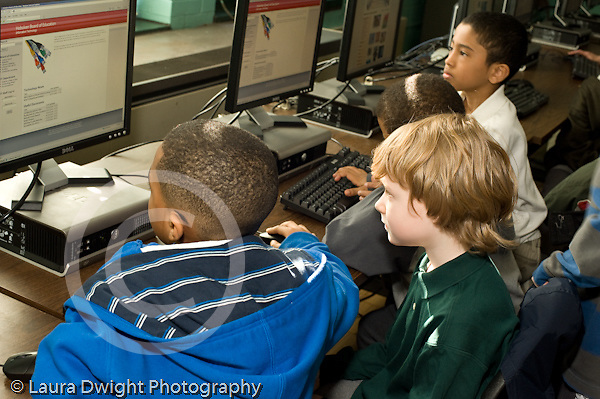 Education Elementary school Grade 2 science computer lab group of male students at work on computers horizontal