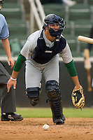 Catcher Jonathan Fixler #40 of the Lexington Legends chases after a wild pitch at Fieldcrest Cannon Stadium April 14, 2010, in Kannapolis, North Carolina.  Photo by Brian Westerholt / Four Seam Images