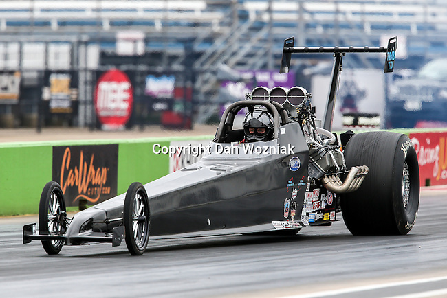 Lizzy Musi wrecks her car during a qualifying pass during the PDRA drag races which were held at the Texas Motorplex in Ennis, Texas.