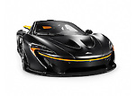 Matte black 2015 McLaren P1 plug-in hybrid supercar isolated sports car on white background with clipping path Image © MaximImages, License at https://www.maximimages.com
