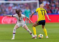 LE HAVRE,  - JUNE 20: Rose Lavelle #16 tries to strip Caroline Seger #17 during a game between Sweden and USWNT at Stade Oceane on June 20, 2019 in Le Havre, France.