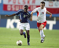 DaMarcus Beasley outruns a Polish defender for the ball. The USA lost 3-1 against Poland in the FIFA World Cup 2002 in Korea on June 14, 2002.