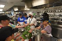 Brittany Eddelbuttel (center) helps teachers on Wednesday July 22 2021 prepare a recipe at Brightwater, the Northwest Arkansas Community College culinary school. Eddelbuttel is an instructor at Brightwater. Go to nwaonline.com/210722/Daily/ to see more photos.<br />(NWA Democrat-Gazette/Flip Putthoff)