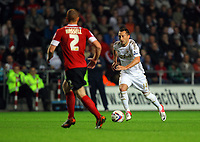 Pictured: Stephen Dobbie of Swansea (R) charging past Bobby Hassell of Barnsley (L). Tuesday 28 August 2012<br /> Re: Capital One Cup game, Swansea City FC v Barnsley at the Liberty Stadium, south Wales.