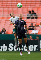 Abby Wambach (20) of the Washington Freedom goes up for a header against Carolyn Blank (3) of Saint Louis Athletica at RFK Stadium in Washington, DC.  The Washington Freedom defeated Saint Louis Athletica, 3-1.