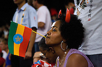23 AUG 2008 - BEIJING, CHN - An Ethiopian supporter watches events unfold - Beijing Olympics. (PHOTO (C) NIGEL FARROW) *** IOC RULES APPLY ON USAGE ***