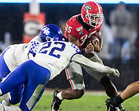 ATHENS, GA - OCTOBER 19: Brian Herrien #35 of the Georgia Bulldogs is tackled by Chris Oats #22 of the Kentucky Wildcats during a game between University of Kentucky Wildcats and University of Georgia Bulldogs at Sanford Stadium on October 19, 2019 in Athens, Georgia.