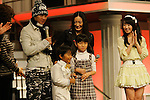 """Tokyo, Dec. 30, 2009 - Nakai MASASHIRO, Seishiro KATO, Yukie NAKAMA, Nozomi OHASHI and Nana MIZUKI (from L to R) are photographed during the second day of rehearsals for 'Kohaku Uta Gassen,' or also more commonly known as 'Kohaku.' Produced by the Japanese public broadcaster, NHK, this annual music show airs on New Year's Eve and ends shortly before midnight, where everyone on air pauses to say """"Happy New Year."""" The 'Red and White Song Battle' separates the most popular music artists during each given year into teams of red and white: the red team consists of all female artists and the white team is all male artists. For an artist to perform on Kohaku, it is a great honor as only the most successful enka singers and J-Pop artist are strictly invited to perform by invitation only. Today, for a J-Pop artist or enka singer to perform on Kohaku, is most notably recognized to be a big highlight in a singer's career due to the show's large reach of audience during New Year's Eve."""
