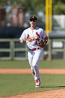 Surprise Saguaros shortstop Tommy Edman (18), of the St. Louis Cardinals organization, jogs off the field between innings of an Arizona Fall League game against the Peoria Javelinas at Surprise Stadium on October 17, 2018 in Surprise, Arizona. (Zachary Lucy/Four Seam Images)