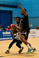 Justin Gordon of Newcastle Eagles drives past Lacey James of Surrey Scorchers during the BBL Championship match between Surrey Scorchers and Newcastle Eagles at Surrey Sports Park, Guildford, England on 20 March 2021. Photo by Liam McAvoy.
