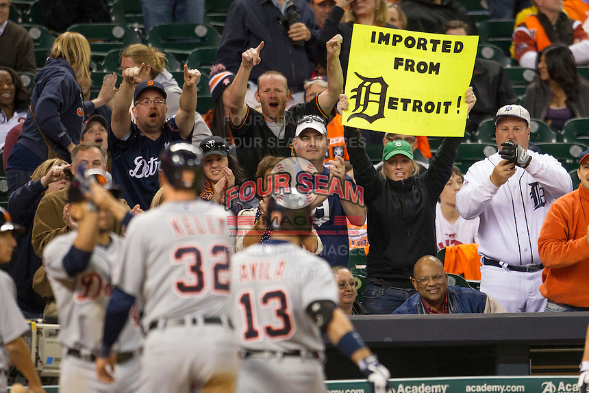 Detroit Tigers fans cheer catcher Alex Avila (13) after he hit a go-ahead two run home run in the ninth inning of the MLB baseball game against the Houston Astros on May 3, 2013 at Minute Maid Park in Houston, Texas. Detroit defeated Houston 4-3. (Andrew Woolley/Four Seam Images).