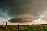 A supercell thunderstorm shows signs of strong rotation as it drifts across the prairies near Woodbine Kansas on June 19th, 2011. This storm produced hail to baseball size along with a small tornado over open country.
