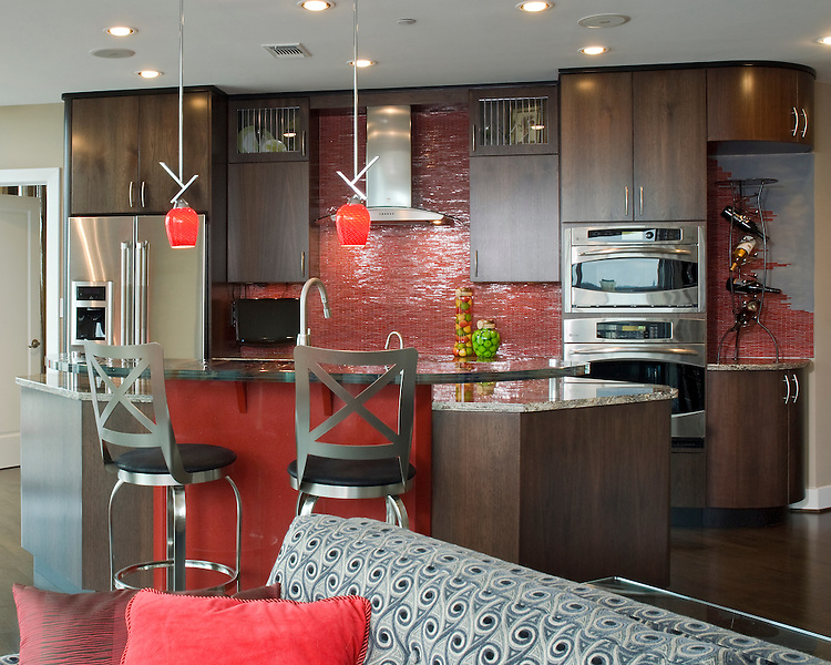 Contemporary Condo Kitchen with Red Accents