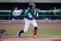 Yordys Valdes (7) of the Lynchburg Hillcats squares to bunt against the Myrtle Beach Pelicans at Bank of the James Stadium on May 22, 2021 in Lynchburg, Virginia. (Brian Westerholt/Four Seam Images)