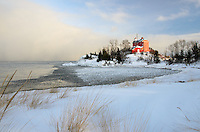 A late afternoon view of the Marquette Harbor Lighthouse with lake-effect snow looming over a frigid Lake Superior. Marquette, MI