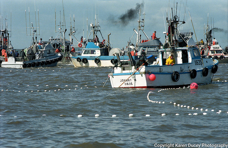 Gillnet fishing boats jockey for a spot to lay out their nets on the North Line of the Egegik River fishing district in Bristol Bay, Alaska. Bristol Bay is home to the world's largest sockeye salmon fishery. The commercial salmon drift gillnet fishing fleet is limited to boats no longer than 32 feet in length. There were over 1,800 permanent entry permits listed in 2002, required per boat. Typically boats fish with two or three deckhands. The fishery is managed by the Alaska Department of Fish & Game and is a sustainable fishery. Peak of the season is around July 4th in this fishery which lasts about a month. The rivers also get a fair amount of chum, king, and chinook salmon. Bristol Bay is located in the southwest part of Alaska.