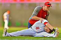 15 June 2012: Washington Nationals Strength & Conditioning Coach John Philbin stretches out Danny Espinosa prior to a game against the New York Yankees at Nationals Park in Washington, DC. The Yankees defeated the Nationals 4-1 to sweep their 3-game series. Mandatory Credit: Ed Wolfstein Photo