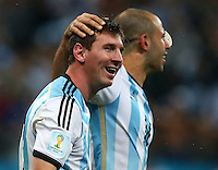 Lionel Messi of Argentina celebrates winning the penalty shootout and qualifying for the World Cup final vs Brazil