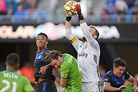 SAN JOSE, CA - SEPTEMBER 30: Seattle Sounders  FC goalkeeper Stefan Frei #24 grabs a ball as Danny Hoesen #9 of the San Jose Earthquakes and Gustav Svensson #4 of the Seattle Sounders FC go for the header during a Major League Soccer (MLS) match between the San Jose Earthquakes and the Seattle Sounders on September 30, 2019 at Avaya Stadium in San Jose, California.