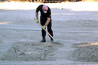 Pictured: Detective Inspector of South Yorkshire Police helps sift through soil in Kos, Greece. Thursday 06 October 2016<br />Re: Police teams led by South Yorkshire Police, searching for missing toddler Ben Needham on the Greek island of Kos have moved to a new area in the field they are searching.<br />Ben, from Sheffield, was 21 months old when he disappeared on 24 July 1991 during a family holiday.<br />Digging has begun at a new site after a fresh line of inquiry suggested he could have been crushed by a digger.