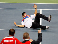 Serbian  Davis Cup player Novak Djokovic reacts after wining match against  France, Davis Cup finals, Serbia vs France in Belgrade Arena in Belgrade, Serbia, Sunday, 5. December 2010. (credit & photo: Pedja Milosavljevic/SIPA PRESS)