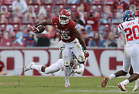 Arkansas wide receiver Treylon Burks (16) carries the ball, Saturday, October 17, 2020 during the fourth quarter of a football game at Donald W. Reynolds Razorback Stadium in Fayetteville. Check out nwaonline.com/201018Daily/ for today's photo gallery. <br /> (NWA Democrat-Gazette/Charlie Kaijo)